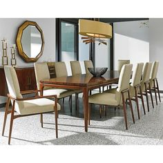 """Simple and chic at first glance, this gorgeous table includes a top of radial matched, cathedral rosewood veneers. Don't be surprised if this stunning, natural design becomes a topic of conversation at your next dinner party or holiday gathering. The rectangular table seats six people, but also includes a removable, 40"""" table leaf that extends the seating space to 122"""" inches, suitable for ten guests."""
