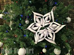3D Paper Snowflakes How To - this is a surprisingly easy DIY for you to learn and make. The 3D Paper Snowflakes look complicated, but are fun and easy to make.