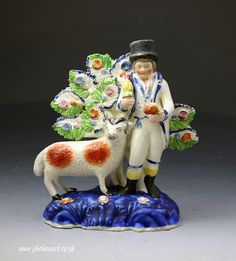 Antique Staffordshire pottery of a farmer standing by a ram modeled on a  distin...