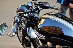 Black Triumph Thruxton with ace bar and mini dashboard / Gopro