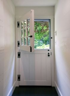 dutch door by jolene. This would be great to keep the dogs inside when I answer the door.
