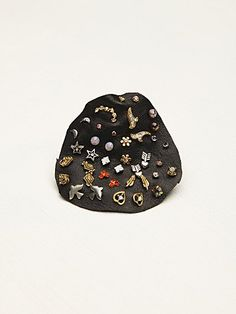 Mega Stud Set | Stones, gems, and charms! These sweet studs come in quite a collection, displayed on a leather patch. Mix and match as you like.  *By Free People