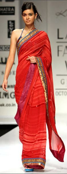 Dirty Diana in a red saree.