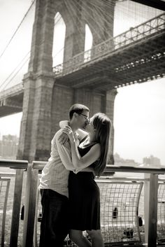 Mr. and Mrs. Hermit Crab pose under the Brooklyn Bridge for their NYC engagement photos by Joel Greenberg