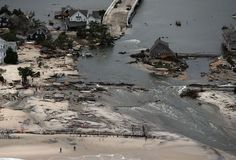 MANTOLOKING, NJ - OCTOBER 31: Homes sit in ruin at the end of a bridge wrecked by flooding from Hurricane Sandy on October 31, 2012 in Mantoloking, New Jersey. At least 50 people were reportedly killed in the U.S. by Sandy with New Jersey suffering massive damage and power outages. Photo: Mario Tama, Getty Images / 2012 Getty Images
