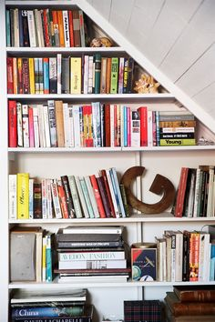Bookshelf as wall to separate spaces/rooms - Attic