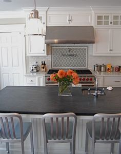 Love the whole set-up of this kitchen. Barstools, countertops, backsplash. Erin, will you come decorate my apartment please?