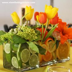 How lovely for a Spring decoration! Flowers and fruit decoration