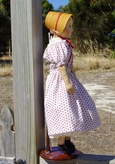 A side view of  reproduction Eliza, a copy of an original Izannah Walker doll. She is currently for sale.