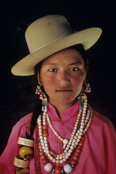 She's beautiful...love the beads on her hair. Tibet | Steve McCurry/Boho Chic/Chloe Garcia Ponce