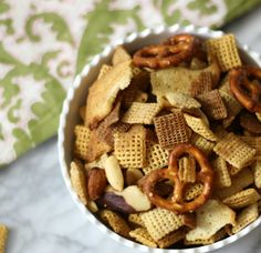 Classic Chex Party Mix #SundaySupper - A light, slightly salty, baked, easy to make classic snack made with Chex Cereal, nuts, pretzels and garlic bagel crisps that has been seasoned with a garlic and onion flavors.