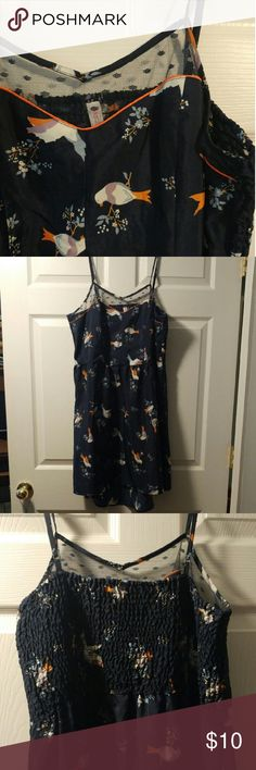 "CUTE Xhiliration Navy Bird Print Dress Soooo cute and in excellent condition! This dress has a  slight high low cut with adjustable straps and a polka dot mesh neckline. The back has a panel of smocked elastic for extra stretch and comfort!  100% polyester.   37"" from top of shoulder strap to bottom of front hem and 40"" to bottom of back hem. 18"" across unstretched and stretches up to about 22"" across. Xhilaration Dresses High Low"