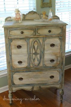 This beautifully distressed dresser by Deneen of Dreamingincolor showcases a layered blend of Aubusson Blue, Pure White and French Linen Chalk Paint® decorative paint by Annie Sloan! We just love the depth, character and detail of this piece!