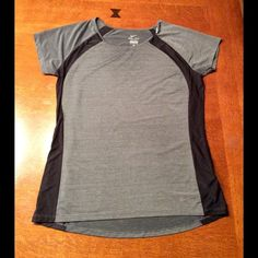 Nike women's dri-fit top. Very cute women's Nike dri-fit top in medium.  Small holes going down 2/3's of the back allow for great breathability of this shirt.  Brand new condition.  92% polyester and 8% spandex.  Nice zipped pocket on lower right side of top. Nike Tops Tees - Short Sleeve