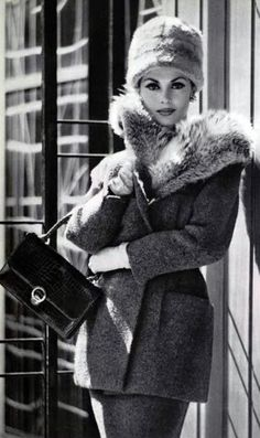 A model wearing a tweed suit by Carven, with a handbag and gloves by Hermès (Paris 1959). Love it