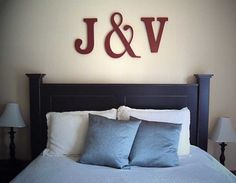 monogram, this might work, hate deciding what goes above the bed, its one of the most difficult areas in the home for me