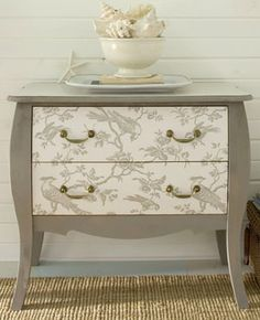 Decorate an old dresser with wallpaper.