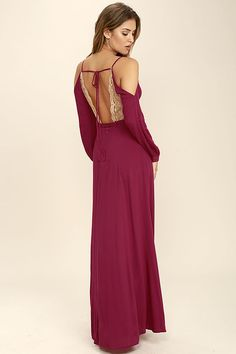 You are free to roam the land in the Wild Orchard Magenta Lace Maxi Dress! Gauzy rayon straps support a sheer, beige lace V-neck, and long, cold shoulder sleeves with button cuffs. Sash belt tops the wrapping maxi skirt with side slit. Open back has a tying strap. Hidden back zipper/clasp.