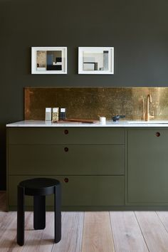 The combination of dark green cabinets with a slice of weathered brass as backsplash is a delicious combination. A bit of brass details can warm up any kitchen and add a unique and colorful dimension not always seen these days.