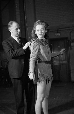 London, 24th December 1943: Stage effects expert Joseph Kirby fixes English actress Glynis Johns to the invisible wires that will enable her to 'fly' during a London stage production of 'Peter Pan'. Ms Johns is playing the title role. Original Publication: Picture Post - 1608 - Mr Kirby's Flying Ballet - pub. 1943 (Photo by Kurt Hutton/Picture Post/Getty Images)