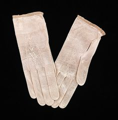 Gloves  Date: 1840–60  Culture: American  Medium: silk  Dimensions: 3 x 7 1/2 in. (7.6 x 19.1 cm)  Credit Line: Brooklyn Museum Costume Collection at The Metropolitan Museum of Art, Gift of the Brooklyn Museum, 2009; Gift of Mrs. Horace Lauder Rutter, 1922  Accession Number: 2009.300.1666a, b  Metropolitan Museum of Art
