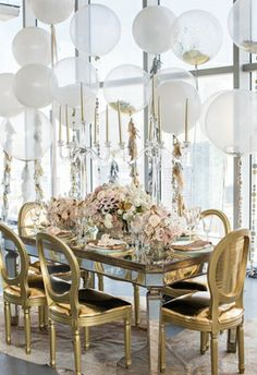 clear balloons filled with confetti and tied with tassels and garlands, huge windows, gilded chairs, mirrored table. Fabulous party setting that could be easily used as inspiration for a wedding. Clear Balloons, Round Balloons, Giant Balloons, Glitter Balloons, White Balloons, Large Balloons, Number Balloons, Long Table Wedding, Wedding Decorations