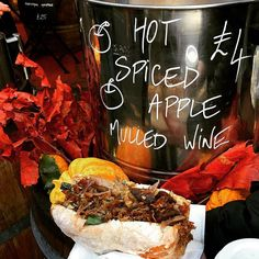 Duck confit sandwich topped with onion chutney, then washed down with spiced holiday mulled wine. Lunch on-the-go at London's bustling Borough Market. Winter Holiday Destinations, Duck Confit, Lunch To Go, Mulled Wine, Pulled Pork, Winter Holidays, Chutney, Onion, Sandwiches