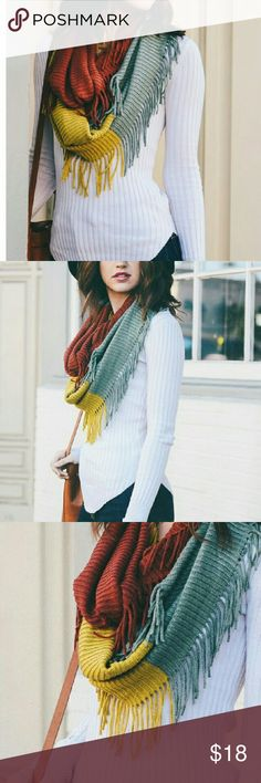 Colorblock Ribbed Infinity with Tassels in Rust Add a Great Accent on your Winter Outfits with our Color-block Ribbed Tassel Infinity Scarf. A Unique Version of our Best Selling Ribbed Infinity Scarf, Get it While it's in Stock! Accessories Scarves & Wraps