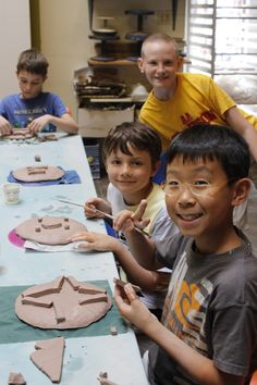 It's Art in the Ocean week at Creativity Camp! Check out some of our campers making plates in the clay studio!