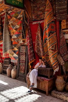 Carpets seller, Medina, Fez, Morocco by Batistini Gaston, via Flickr This is the setting of Garment of Shadows, a Mary Russell and #SherlockHolmes #mystery by Laurie R. King. #morocco #orientalrugs #rugs #carpets