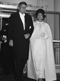 Jacqueline Kennedy wore an off-white sleeveless gown of silk chiffon over peau d'ange to the 1961 inaugural balls. Its strapless bodice under the chiffon covering is encrusted with brilliants and embroidered with silver thread. Ethel Frankau of Bergdorf Custom Salon designed and made the dress based on sketches and suggestions from Mrs. Kennedy. It was worn with a matching cape