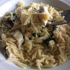 "Garlic Chicken with Orzo Noodles | ""This is a simple recipe with a spicy kick for garlic lovers. It is my combination of a much loved linguine and clam sauce dish and a recent introduction to orzo pasta."""