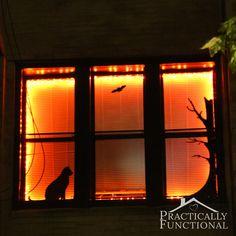 Halloween Window Decor: Decorate a window with black vinyl and orange string lights!