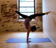 Handstand Split: Although the goal of the handstand pose in yoga is to be able to hold your body in one straight line, it's really difficult to find that balance at first. Doing a handstand with your legs in split position is much easier. Do it in front of a wall with your toes leaning for support, and eventually move away when you master the balance.