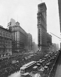 This 1919 photo shows a crowd gathering to see the score of the World Series from a scoreboard on Times Tower. Adolph Ochs, owner of New York Times, convinced Mayor George McClellan to rename the area Times Square, in honor of his newspaper.