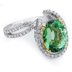 Brides.com: Engagement Rings With Colored Stones. 18k white and yellow gold ring with oval green tourmaline center stone and diamonds, Style R2059, Parade Design See more oval-cut engagement rings.