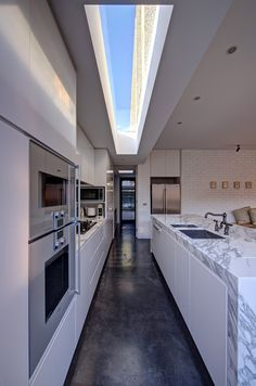 Allowing natural light to fall in the kitchen - fantastic way to incorporate sunlight into the house and alleviate that sense of pressure and industrial feel that often define the modern kitchen space.