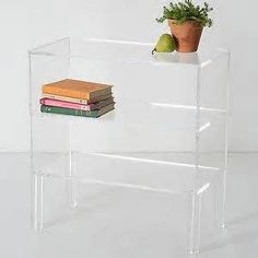 Office Space: Clear glass shelving table that goes up against the solid brick wall behind Felicity desk.
