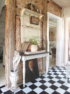 Exposed timber and brick wall with black and white chequered floor for a stylish, rustic home