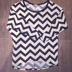 Black and cream stripped shirt Black and cream stripes, full length sleeves, loose and then tighter around the hips, XS but fits more like a small (runs big), only worn a handful of times Charlotte Russe Tops