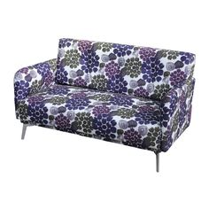 Featuring a modern design, this Emma loveseat has chrome-finished angular legs with a solid wood construction. The loveseat is upholstered in purple fabric with a colorful floral print throughout.