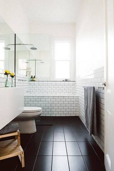 perfect for second full bathroom matches master but without separate bath and shower dark tile floor and subway tile wall white tiles with dark grout