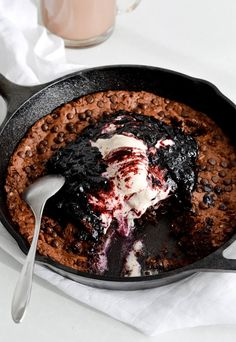 Oatmeal fudgy skillet cookie   blueberry sauce