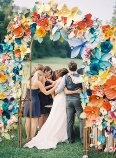 Paper flower arch for wedding ceremony. #DIY