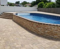 Radiant 12x24 Semi-Inground Oval with walk-in steps and pavers