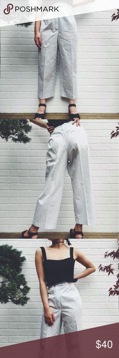 🆕 Pale Blue High Waisted Trousers High Waisted Pale Blue Trousers. These are perfectly cropped and in the most unique pale blue! Looks more white on camera. As seen on a 5'3 petite model. Will fit waist 2/4 best! Vintage brand tag and has pockets at the back! #croppedpants #highwaistedpants #croppedtrousers #highwaistedtrousers #vintagepants Topshop Pants Ankle & Cropped
