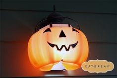Awesome idea! cut a cheap jack-o-lantern bucket and make it a light fixture. #halloween