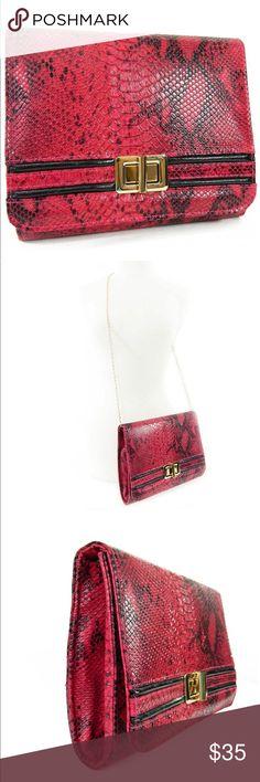 "Fuschia Pink and Black Python Clutch Color: Fuschia and Black;  1-interior zipper pocket;  turn lock closure;  chain link shoulder strap option;  dimensions: 10-1/4"" x 8-1/2"" x 1-1/2"" Bags Clutches & Wristlets"