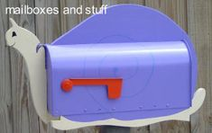 Offering Unique Garden Criter Mailboxes, ladybug, gecko, snail and frog mailboxes
