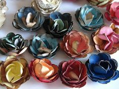 My friend, Wendy, made these paper flowers from scrap papper my mom gave her. Cool.